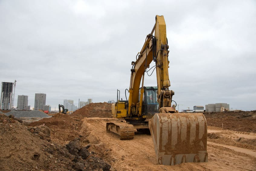 Backhoe digging at a construction site